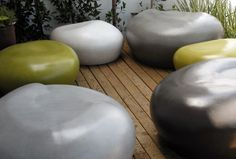 Indoor/outdoor pebbles  by EIS Studio were featured in Dwell Outdoor. The pebbles come in four different materials: cast stone, fabric, fiberglass, or wood. #dwellondesign #dod2012