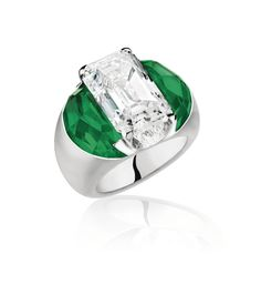 Gold, Emerald and Diamond Ring, Olivier Reza The impressive geometric ring featuring an emerald-cut diamond weighing 9.88 carats and framed by 2 half-moon shaped Colombian emeralds weighing 11.44 carats.