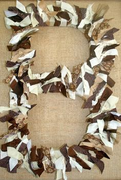 saw the cardboard letters in joanne fabrics.. love how they decorated this-- maybe i can use grey,pink, and burlap ribbon?