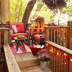 This porch is bursting with beautiful fall color! More fall decorating:  http://www.bhg.com/halloween/outdoor-decorations/fall-outdoor-decorating-from-halloween-to-thanksgiving/?socsrc=bhgpin101313porch&page=14