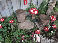 Wood thrift shop bowls painted and turned upside down into toad stools!
