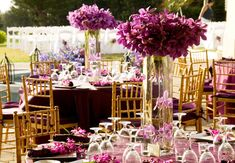 Purple Submerged Orchid Centerpieces  // Photo by: Photography on Maui / A White Orchid Wedding Inc // 6 Statement Orchid Centerpieces: http://blog.theknot.com/2013/07/19/submerged-orchid-centerpiece-ideas/