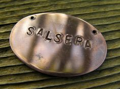 """Stamped Oval Salsa Dance Necklace in Spanish: """"Salsera"""" Copper. $21.00, via Etsy."""