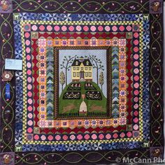 """Miko Rules"" by Ann Reed, Des Moines Area Quilt Guild 2013 award winner, pieced and appliqued medallion quilt with multiple borders."