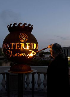 Barnaby Evans, creator of WaterFire, lights the first torch for Inaugural WaterFire Sharon, PA (photo taken by Alex Bellotti from Commonwealth Media Services)