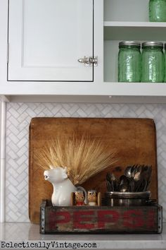Vintage wood Pepsi crate looks cute in the kitchen - love the cow creamer filled with wheat from HomeGoods eclecticallyvintage.com #HomeGoodsHappy #HappybyDesign #sponsored