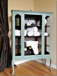china hutch turned linen cabinet for master bathroom. Layered finish - paint the entire piece a moss green using Annie Sloan, followed by turquoise. You can see the color variations.