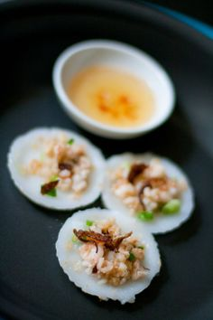 Vietnamese Banh Beo (steamed rice cake topped w/ chopped shrimp  scallions)