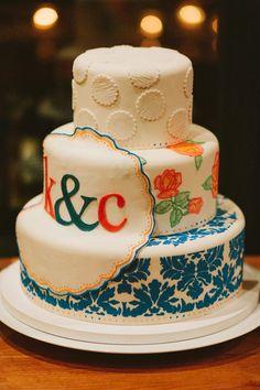 blue, orange, and white wedding cake