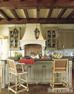 range hood, lights, display shelves flanking the range, pretty cabinets and hardware