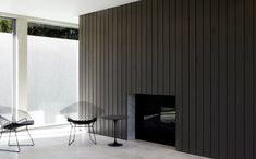 :: FIREPLACES :: adore the dark vertical panelling, frameless recessed fireplace insert - simple yet timeless #fireplaces