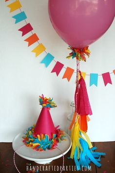 DIY party hats and balloon wand by Handcrafted Parties