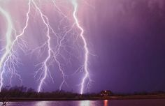 Lightning strikes behind storm chaser James Menzies' house in Norman, Oklahoma