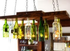 You'll love to learn how to make this fabulous Wine Bottle Chandelier and it will look beautiful in your home.