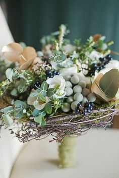 wedding bouquet in a bird's nest - so cute! photo by Katie Purnell http://ruffledblog.com/intimate-irish-wedding #weddingbouquet #bouquet #flowers