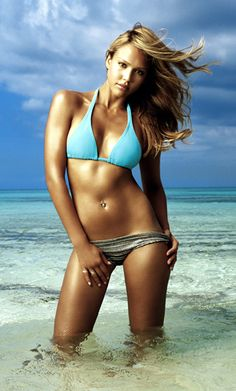 Jessica Alba shoots a promo shot for Into the Blue in 2005, increasing popularity in swim separates too bad no one remembered the movie:)