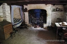 Peat fire inside an old thatched irish cottage.