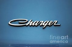 Charger badge. From my eyes, through the view finder to the click of the shutter. I hope you enjoy these moments in time that have been captured. Stop by and check out some of my other Galleries on Fine Art America. Just simply search for Thomas Woolworth. Photographer (1977), Digital Artist and Owner V'CAD Support (since 1987). email: mailto:Tom510@aol...
