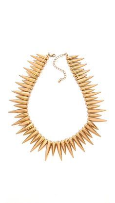 Spike choker necklace. Ooh, want. (I'm having a spiked jewelry thing this year.)