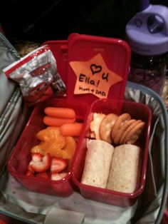 Turkey cheese wrap in wheat tortilla, crackers, cheese, carrots, orange slices, strawberries and a special treat!