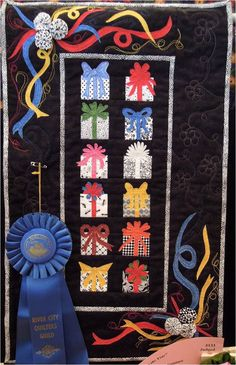 """Presents Throughout the Year"", 13 x 22, by Diana Muenzler.  First prize, miniature quilt.  Photo by Quilt Inspiration."
