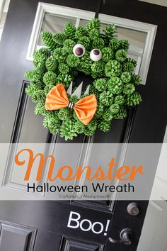 I'm not a big Halloween decorator, but this is SO cute!  Halloween Monster Wreath made with pinecones and spray paint - Cheap, easy DIY wreath. Love the texture!
