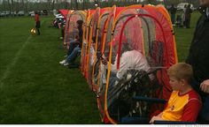 """""""Soccer mom"""" rain tent for folding chair. I see this in my future..."""