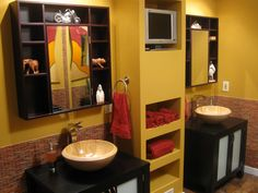 20 Stylish Bathroom Storage Ideas: A vibrant built-in unit creatively separates the his and her sinks in this master bath. The open shelves of the mirrors provide space to display stylish accessories, while the built-in shelves create easy access linen storage. From DIYnetwork.com