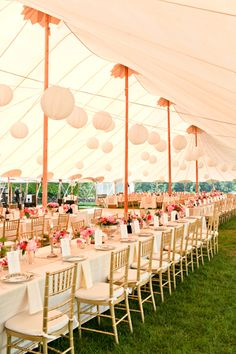 Southern Tent Wedding. My heart has been set on a barn, but I actually like this tent! Love the long tables and the gold chairs.