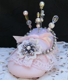 Altered baby shoe pin cushion