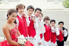 Great color for your Quinceanera! Chambelanes are looking good in white and black tuxedos with pomegranate/red accessories.