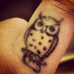 Tiny owl finger tattoo