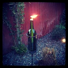 Wine Bottle Tiki Torches, in a stand