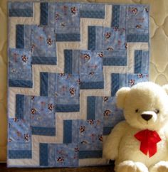 Penguins on Parade is a handmade baby quilt.