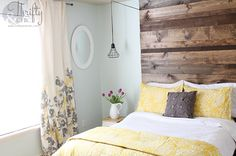 yellow / gray / white / mint bedroom, wood headboard