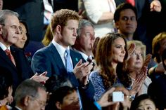 Royal lineup... (From left) IOC president Jacques Rogge, Prince Harry and the duchess of Cambridge take in the closing ceremony.