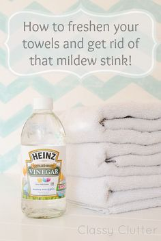 Wash your load of towels on the hot cycle and add 1 cup of vinegar… just hot water and the vinegar, nothing else. Let the washer do it's job. Then, if you still smell a little bit, rewash with just hot water and 1/2 cup of baking soda. Again, no detergent, just baking soda and hot water. Voila!