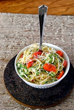 Healthy Lemon Zucchini Pasta - Zippy lemon, tart yogurt, and a bite of pepper sauce this delicious lower carb pasta dish where half the pasta has been swapped for zucchini!