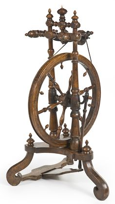 An exceptional 19th Century French walnut and mixed timber spinning wheel    C 1810