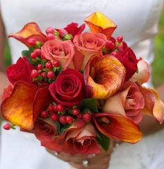 Fall Wedding Roses  ~Roses can be part of any fall bouquet and work well with a variety of other blooms, including calla lilies, sunflowers, daisies, mums, and other fall favorites. Rich, bold colors are popular for fall bouquets, and red, orange, and yellow roses will always work.