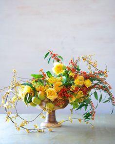 A yellow centerpiece for a late-summer wedding   Brides.com