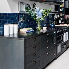 Blue tiles for the backsplash coupled with dark cabinets