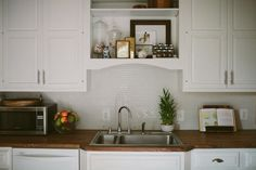 wooden counter tops, small subway tile