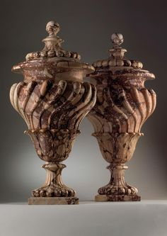 *ROMAN, 18th Century. A pair of breccia Corralina vases and covers.  75 cm high.