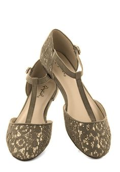 Endearing Demeanor Flat Accentuate your already-charming mannerisms with these sage-green T-strap flats! Parade around with this darling vegan faux-leather shoe's gold glitter sparkling beneath each toe and counter's embroidered-lace overlays. Affix this pair's adjustable gold-buckled ankle strap below an A-line shirt dress, cream cardigan, and rosy earrings, and you'll have a look that's a perfect match for your winning personality!
