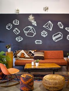 70s inspired lounge via @Design*Sponge -- you gotta love the geometric shapes on the wall. Maybe I could do something similar with colored tape?