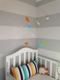 What a fun and funky child's mobile! #nursery #nurserydecor