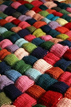 Easy knit blanket. Could use strips from a knitting loom.