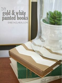 Spray painted books with FrogTape Shape Tape