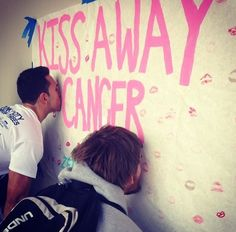 """ZTA (Florida Gulf Coast University) held a """"Kiss Away Cancer"""" event to raise money and spread awareness on campus."""